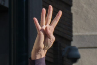 Protesters at the Capitol in Juneau raised four fingers in support of the Fairbanks 4 on Oct. 24, 2015.