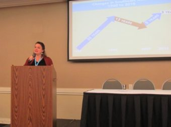 """Meilani Schijvens of Rain Coast Data presents the annual """"Southeast By the Numbers"""" report at Southeast Conference. (Photo by Leila Kheiry/KRBD)"""