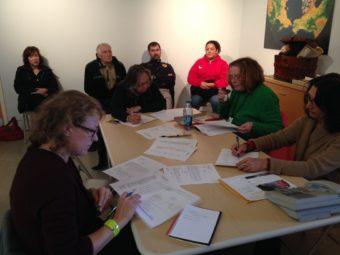 Museum of the Aleutians' Oct. 12 board meeting. Board members (at table, L-R) Melissa Good, Sharon Svarney-Livingston, Eilleen Scott and executive director Zoya Johnson. (Photo by Greta Mart/KUCB)