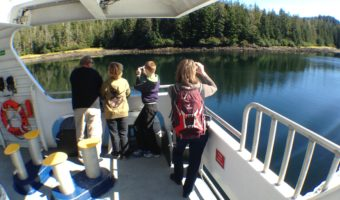 Passengers enjoy the scenery during a Sept. 3 fast ferry Chenega sailing between Sitka and Juneau. Sitka would lose most of its ferry service under a schedule based on a reduced budget proposed by Gov. Bill Walker. (Photo by Ed Schoenfeld/CoastAlaska News)