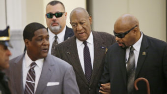 Bill Cosby arrives for a court appearance Wednesday in Norristown, Pa. The judge has ruled that the case against him will proceed, despite a claim that he was promised immunity a decade ago. Ed Hille/AP