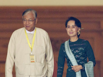 U Htin Kyaw (left), newly elected president of Myanmar, walks with National League for Democracy leader Aung San Suu Kyi at Myanmar's Parliament in Naypyitaw on Tuesday. Aung Shine Oo/AP