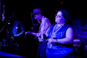 A picture Colette Costa playing the triangle with the North Country Cajun Club at the Red Dog Saloon on Friday, Feb. 5, 2016. (Photo by Annie Bartholomew/KTOO)
