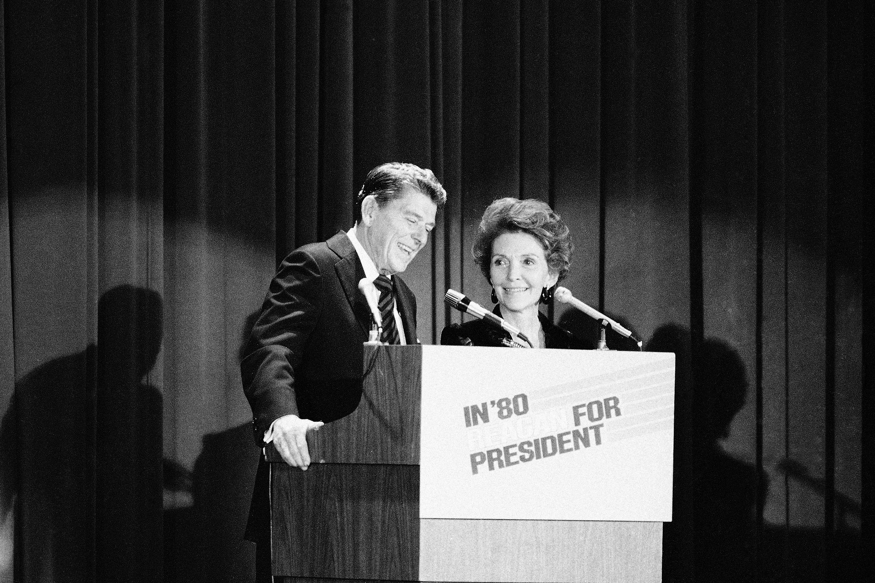 the former california governor and his wife address a crowd at a gop