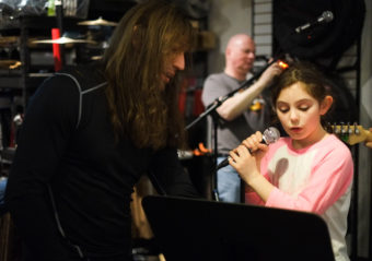 Instructor Ward F. Ward and daughter Cadence Ward rehearse with School of Rock Sessions band 3, 2, 1... at Alaska Music One. (Photo by Annie Bartholomew/KTOO)