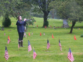 The playing of Taps concludes Memorial Day observances at Evergreen Cemetary.