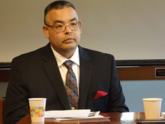 Bill Seward listens to assembly members during an interview Saturday. (Photo by Emily Files/KHNS)