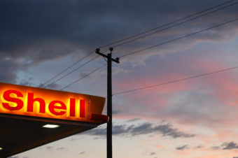 Shell sign gas station logo at sunset