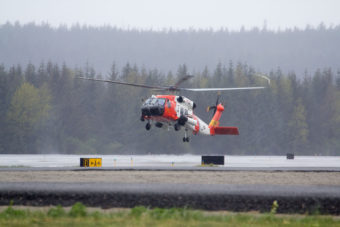 A US Coast Guard helicopter lands at Juneau International Airport on Thursday May 5th, 2016. (Photo by Mikko Wilson / KTOO)