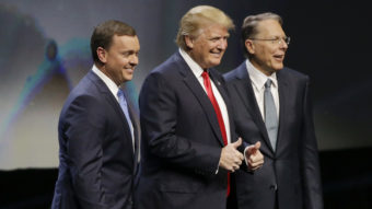 Donald Trump is introduced by National Rifle Association executive director Chris Cox (left) and NRA executive vice president Wayne LaPierre on Friday at the organization's convention in Louisville, Ky. Mark Humphrey/AP