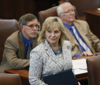 Oklahoma Gov. Mary Fallin walks on the floor of the Oklahoma House on Wednesday. On Friday, Fallin vetoed legislation that would make it a felony for doctors to perform an abortion. Sue Ogrocki/AP