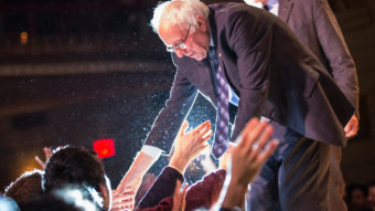 Democratic presidential candidate Bernie Sanders shakes hands with supporters in January in New York City. Andrew Burton/Getty Images