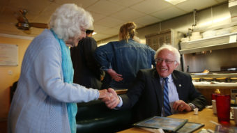 Madonna Rea shakes hands with Democratic presidential candidate Bernie Sanders as he has breakfast at Peppy Grill on Tuesday in Indianapolis. JOE RAEDLE / GETTY IMAGES