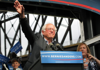 Democratic presidential candidate Bernie Sanders waves to the crowd after arriving Tuesday at a campaign rally at the Big Four Lawn Park in Louisville, Ky. John Sommers II/Getty Images