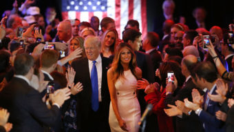 Donald Trump and his wife, Melania, arrive to speak to supporters at Trump Tower in New York following his victory in Indiana Tuesday. Improbably, Trump is now assured of being the GOP nominee. Spencer Platt/Getty Images