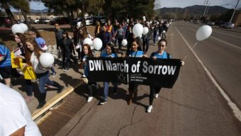 Middle school students in Santa Fe, N.M., march to honor DWI death victims. States like New Mexico, where alcohol-related deaths are above the national norm, have been mining data to raise awareness of preventable deaths. AP