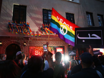 Mourners gather outside of the iconic New York City gay and lesbian bar the Stonewall Inn to light candles, lay flowers and grieve for those killed in Orlando last evening on June 12, 2016. Spencer Platt/Getty Images