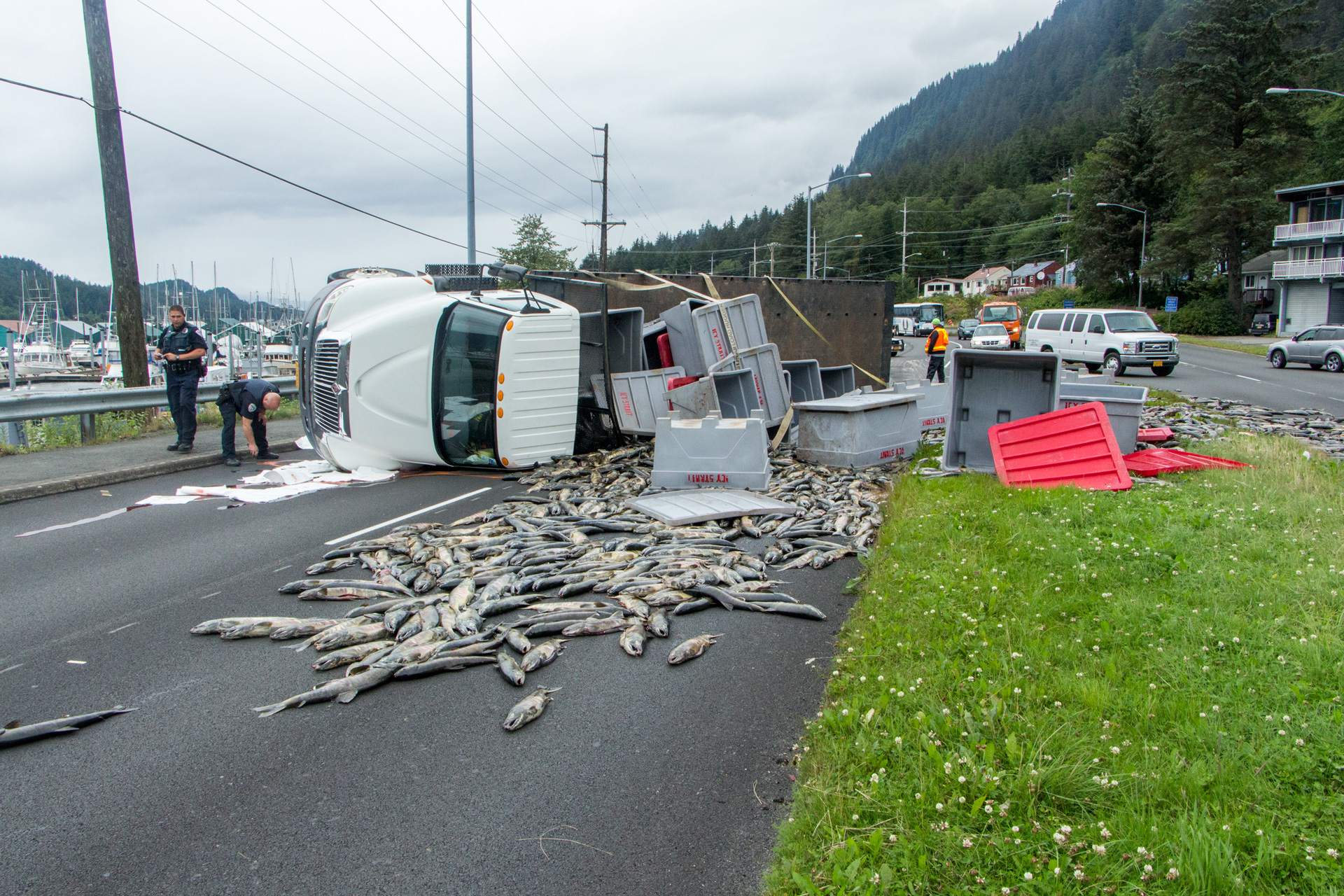 Overturned Truck Blocks Egan With Load Of Fish