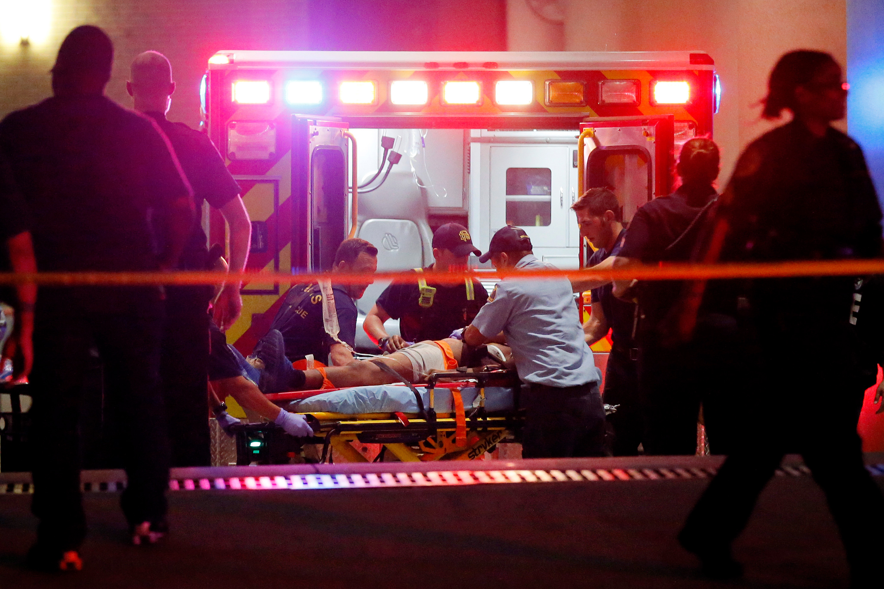 Emergency responders administer CPR to an unknown patient on a ...
