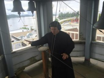 Deacon Herman Madsen plays the bells atop St. Michael's Cathedral. (Katherine Rose, KCAW)