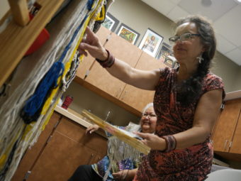 Clarissa Rizal is an artist who specializes in the design and creation of Tlingit regalia, including Chilkat and Ravenstail robes and weavings. Rizal regularly conducts workshops and apprenticeships to help revive the Chilkat style of weaving. (Photo by Tripp J Crouse/KTOO)