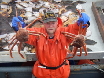 Bob Foy, director of the NOAA lab in Kodiak, holds up tanner crab, a species expected to be impacted by ocean acidification. (Photo courtesy NOAA's Fisheries Science Center)
