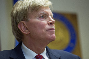 """Former Ku Klux Klan leader David Duke talks to the media at the Louisiana secretary of state's office in Baton Rouge, La., on July 22, after registering to run for the U.S. Senate. """"The climate of this country has moved in my direction,"""" Duke said as he announced his candidacy, one day after Donald Trump accepted the GOP nomination for president. Max Becherer/AP"""