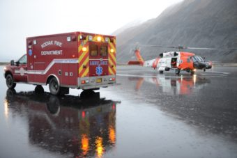 A Coast Guard Air Station Kodiak, Alaska, MH-60 Jayhawk helicopter crew transfers a patient to an ambulance in Kodiak, Alaska, Feb. 19, 2016. The patient was medevaced from fishing vessel Providence in Lazy Bay on the southern point of Kodiak Island.