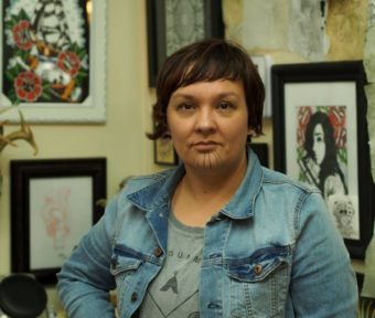 Holly Mititquq Nordlum at Above The Rest tattoo shop in Anchorage, where she's working to meet the state's official requirements to be eligible for a tattoo license.