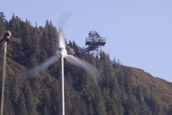 Wind spins a turbine at Coast Guard Station Juneau, Sept. 29, 2016. The Goldbelt Mount Roberts Tramway is visible between the blades. (Photo by Jeremy Hsieh/KTOO)