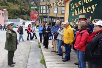 Park ranger Charlotte Henson leads a group of visitors on a walking tour of Skagway focused on the story of Company L. (Photo by Emily Files/KHNS)