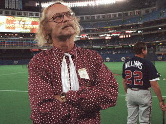 Canadian author W.P. Kinsella standing on the baseball field before game five of the 1992 World Series between Toronto Blue Jays and Atlanta Braves in Toronto, Ontario. Rusty Kennedy/AP