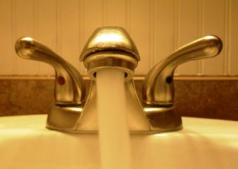 Faucet and running water. (Photo courtesy of KCAW)