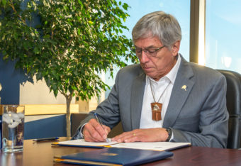 Lt. Gov. Byron Mallott signs a statement of cooperation with British Columbia Thursday. It targets protecting transboundary rivers. (Photo courtesy Office of the Governor)