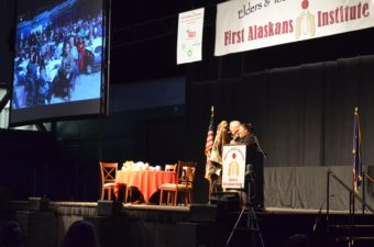 Liz Medicine Crow, president and CEO of First Alaskans Institute, and board chair Willie Hensley give opening remarks at the 33rd annual Elders and Youth conference in Fairbanks. (Photo by Jennifer Canfield)
