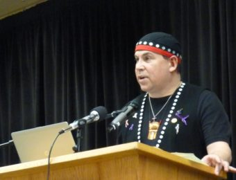 The Tlingit-Haida Central Council's Rob Sanderson Jr. talks about transboundary mining concerns at a Native Issues Form on March 9, 2016, in Juneau. (Photo by Ed Schoenfeld/CoastAlaska News)