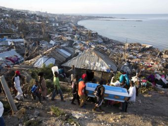Residents carry a coffin containing the remains of a pregnant woman killed by Hurricane Matthew, in Jeremie, Haiti. People across southwest Haiti are salvaging what they can from wreckage the Category 4 storm caused. Dieu Nalio Chery/AP