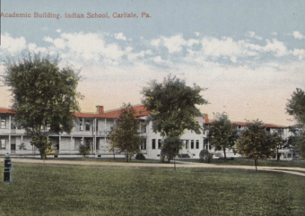 The caption on this artwork reads Academic Building, Indian School, Carlisle, PA. (Public Domain image from National Archives and Records Administration)