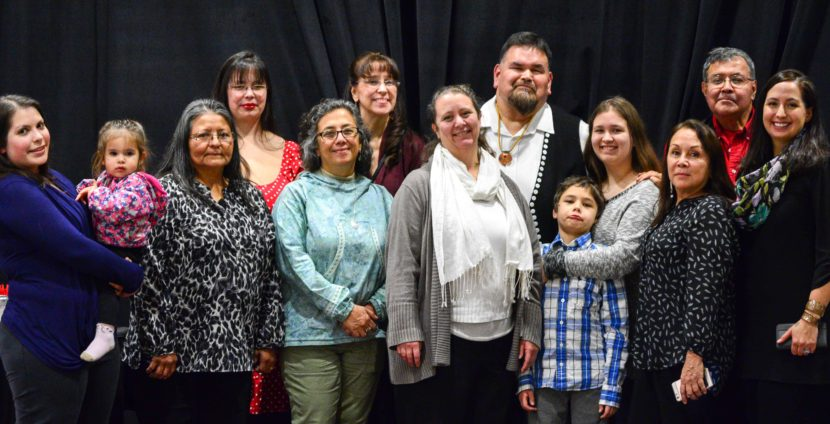 Alfie Price poses with his family and friends after he was honored as a language warrior during a Nov. 22, 2016, awards ceremony. (Photo courtesy Central Council of Tlingit and Haida Indian Tribes of Alaska)