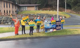 Democrat Jonathan Kreiss-Tomkins, center, campaigns with supporters in Sitka on Election Day, Nov. 8, 2016.
