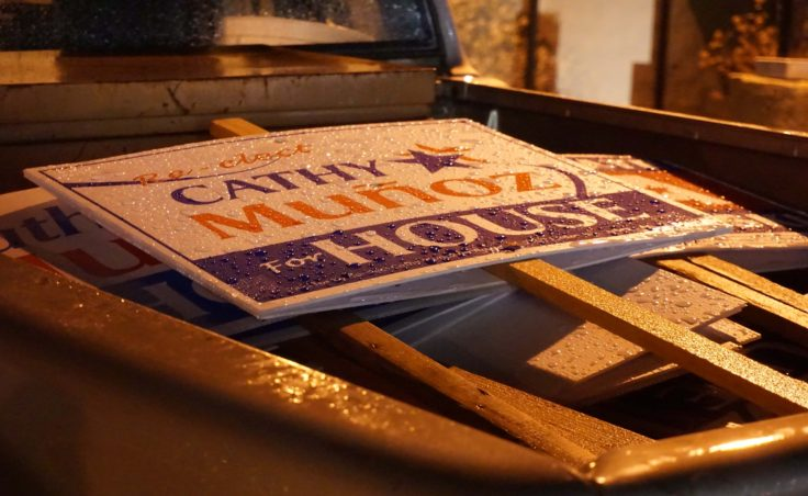 Rain beads on Cathy Munoz campaign signs in the back of a truck outside her campaign party, Nov. 8, 2016. (Photo by Jeremy Hsieh/KTOO)