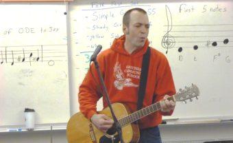 Gastineau Elementary School music teacher Patrick Murphy leads his class in song. (Photo by Ed Schoenfeld/CoastAlaska News)