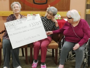 Pioneers Home residents with the big check, representing the proceeds of this year's Rotary Interact pie sale. (Photo by Leila Kheiry)
