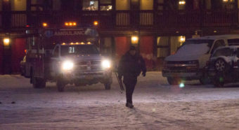 An ambulance and Juneau police officer at the Driftwood Hotel, Dec. 16, 2016. (Photo by David Purdy/KTOO)
