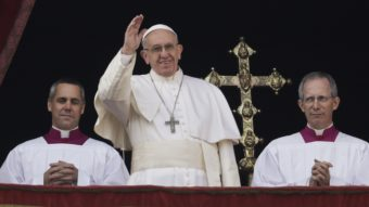 Pope Francis delivered his Christmas day blessing from the main balcony of St. Peter's Basilica at the Vatican Sunday, before a crowd of some 40,000 people. Alessandra Tarantino/AP