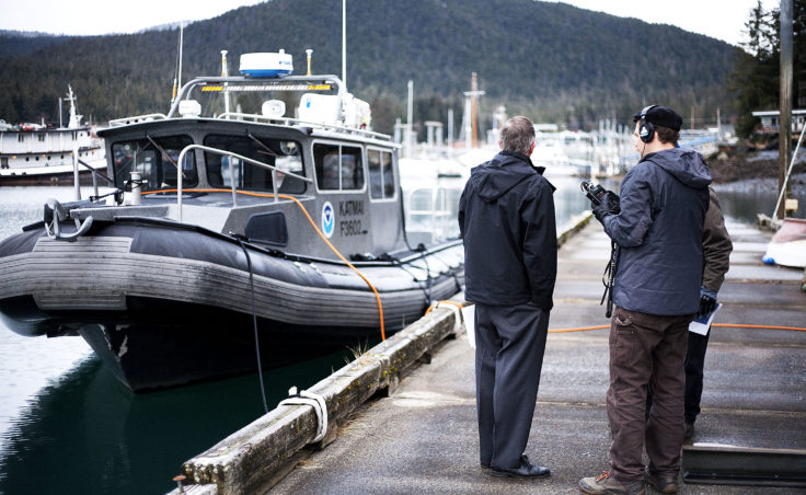 Juneau Docks and Harbors port director Carl Uchytil answers questions for KTOO reporter Jacob Resneck during a tour of the Auke Bay Marine Station property with port engineer Gary Gillette on Tuesday, Jan. 31, 2017. The city would like to expand Statter Harbor and begin utilizing the Auke Bay Marine Station property. (Photo by Tripp J Crouse/KTOO)