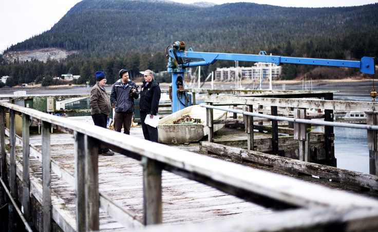 Juneau Docks and Harbors port engineer Gary Gillette listens as KTOO reporter Jacob Resneck interviews port director Carl Uchytil about the city's proposed expansion of Statter Harbor at the Auke Bay Marine Station property on Tuesday, Jan. 31, 2017. (Photo by Tripp J Crouse/KTOO)