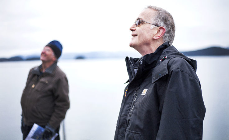 Juneau Docks and Harbors port engineer Gary Gillette and port director Carl Uchytil look at the Auke Bay Marine Station property on Tuesday, Jan. 31, 2017, during a tour of the property. (Photo by Tripp J Crouse/KTOO)