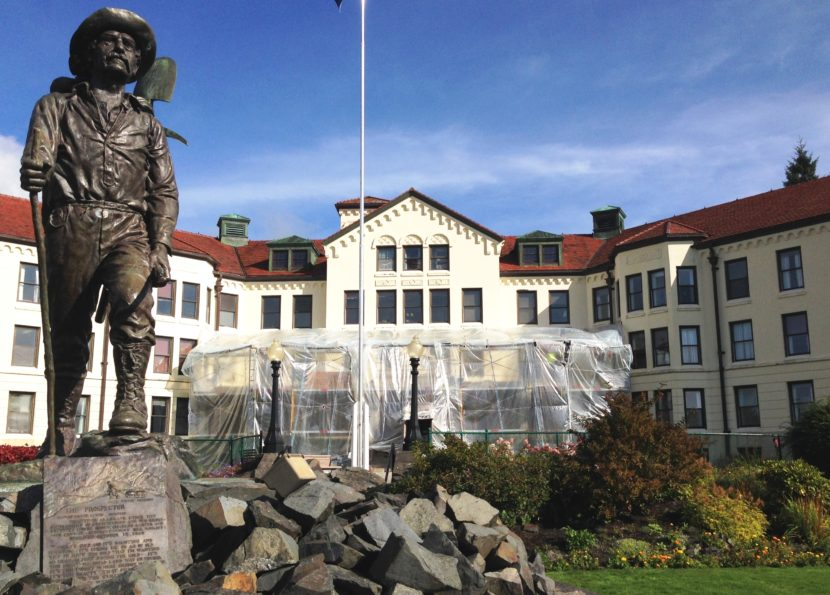 """The Prospector"" statue stands in front of the Sitka Pioneers Home entrance, which was under repair Sept. 20, 2016. The homes reduced admissions as budgets were cut. (Photo by Ed Schoenfeld/CoastAlaska News)"