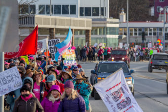 Protesters walk along Egan Drive as part of the Women's March on Saturday, Jan. 21, 2017, in Juneau. (Photo by Mikko Wilson/KTOO)